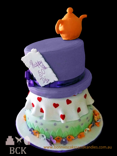 Diane's purple Mad Hatter cake with a touch of orange and green.