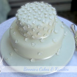 This elegant, ivory-on-ivory Brisbane wedding cake was a gluten & gelatine free macadamia nut cake with white chocolate & macadamia buttercream filling .