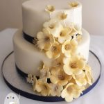 Traditional fruit cake with edible blossoms for an intimate New Years Eve wedding at Montville Lake Terrace.