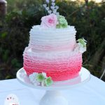 Pink ombre ruffles for a poolside wedding reception at Kingfisher Bay Resort on Fraser Island. Choc-hazelnut and white chocolate mud flavours.
