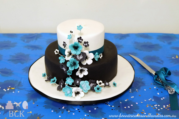Timara's & Kane's black and white engagement cake with black, white & blue flower paste blossoms | Bonnie's Cakes & Kandies, Gympie.
