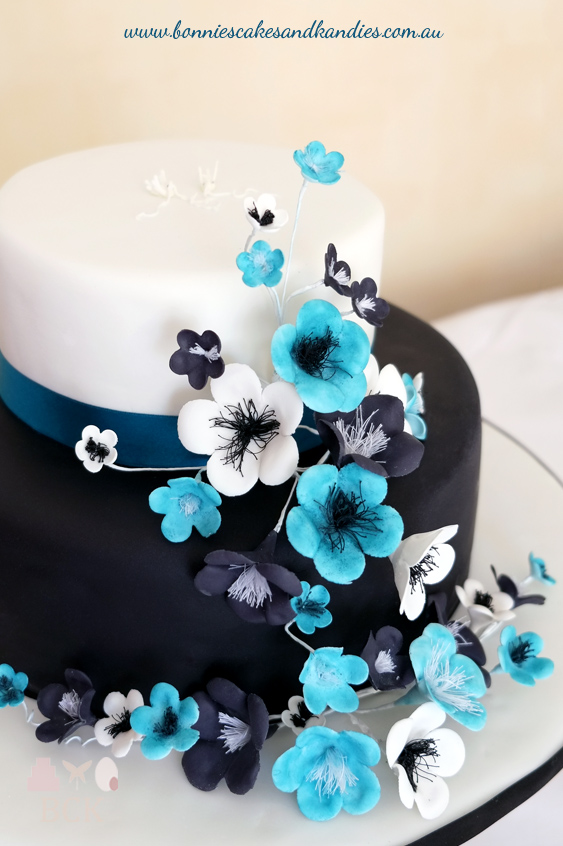 Timara & Kane's black and white engagement cake was brought to life with pops of blue | Bonnie's Cakes & Kandies, Gympie.
