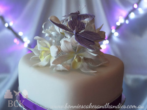 Purple butterflies, white Singapore orchids, rosebuds and leaves  |  Bonnie's Cakes & Kandies, Gympie.