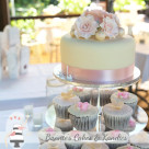 Elegant cupcake tower cutting cakes