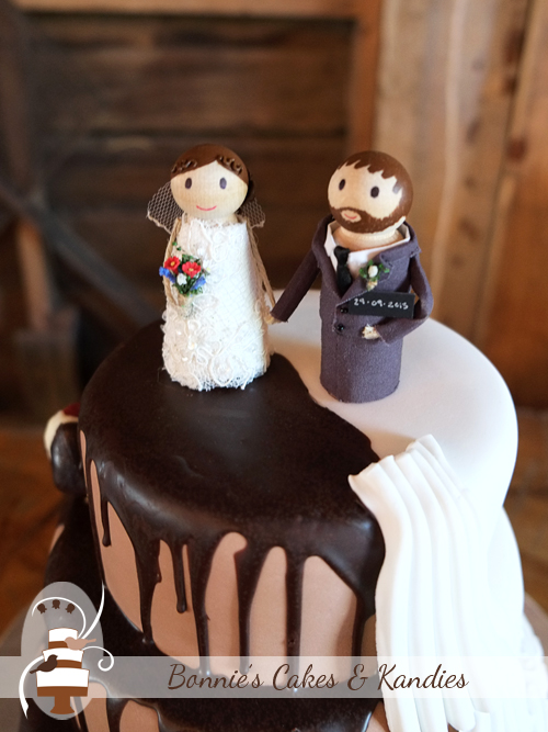 Personalised cake toppers made by the very talented bride     Bonnie's Cakes & Kandies