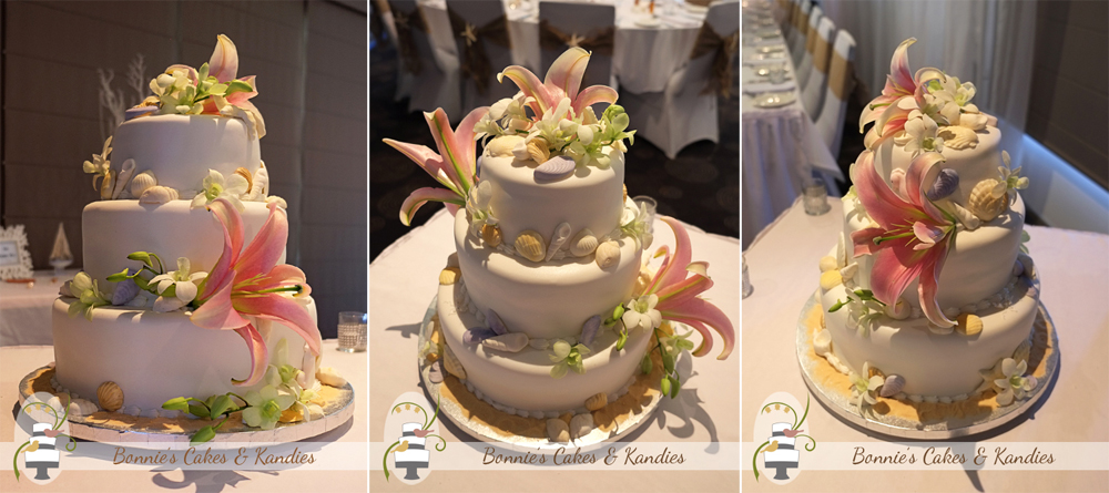 Edible seashells and fresh Oriental lilies and Singapore orchids decorated this beach-themed wedding cake | Bonnie's Cakes & Kandies