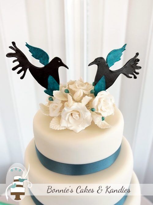 Custom made lovebird cake toppers were match to the wedding invitations to tie in the lovebirds theme  |  Bonnie's Cakes & Kandies
