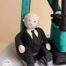 Edible icing groom sitting in digger cab cake topper Gympie Brisbane wedding cake topper