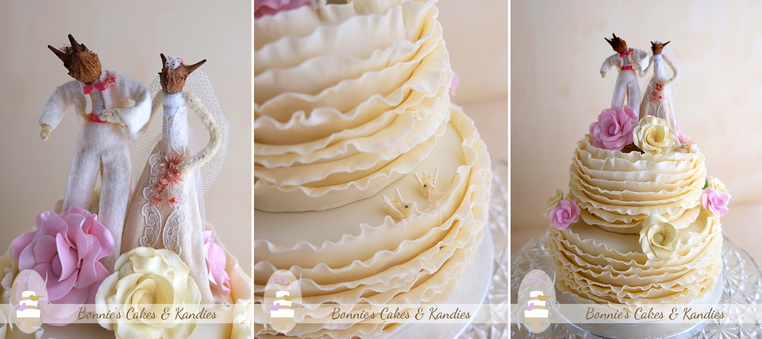 White and dark chocolate mud cake make up the tiers of this romantic, ruffle wedding cake with icing flowers and kangaroo cake toppers, made for a gorgeous Gympie wedding.
