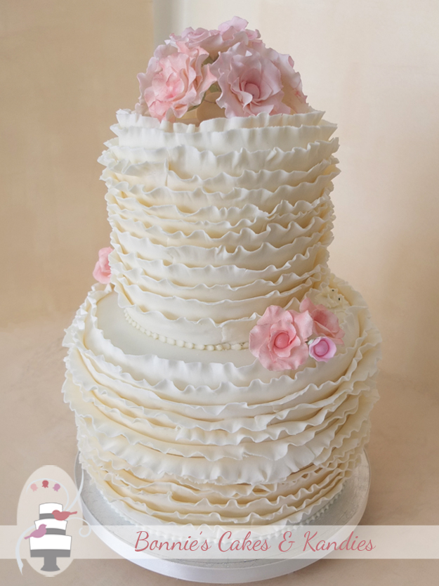 Gold Coast wedding cake with ivory ruffles and fantasy flowers in shades of pink - Bonnie's Cakes & Kandies, Gympie