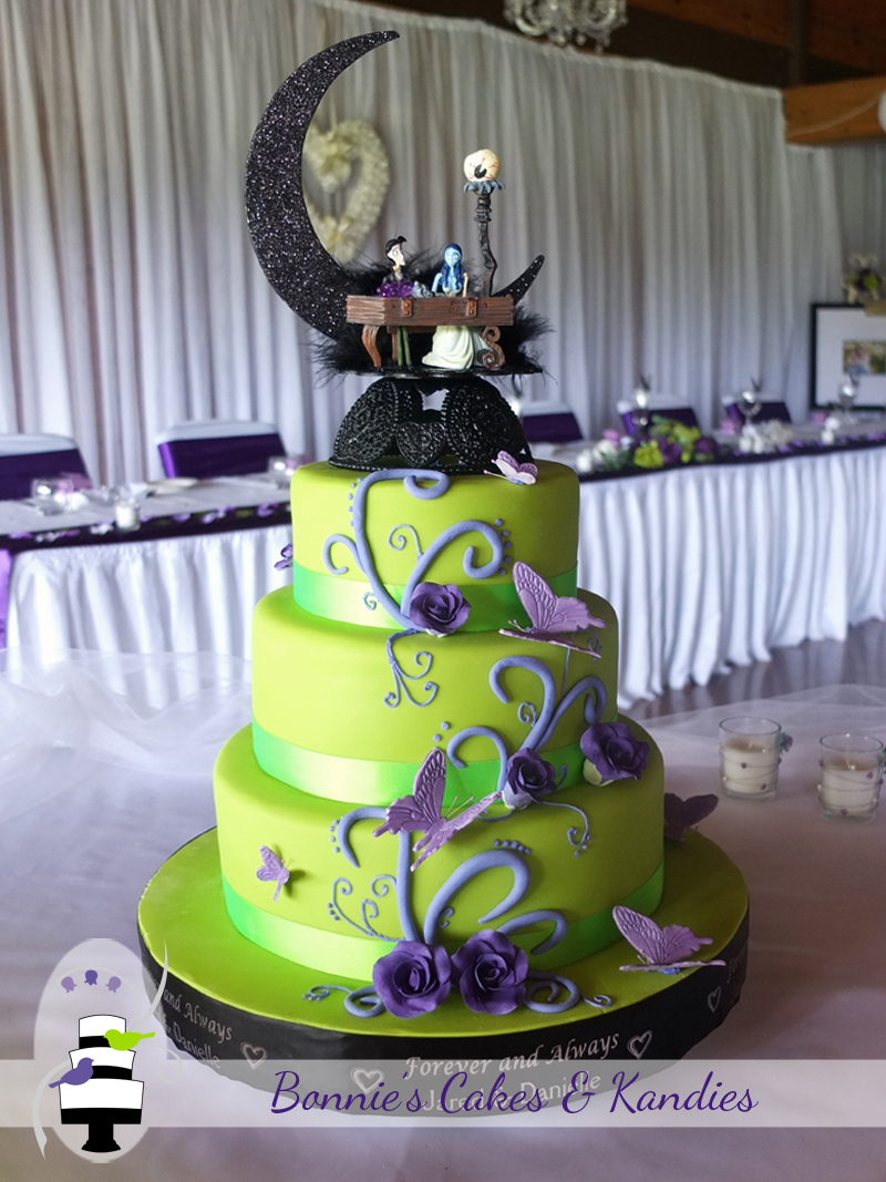 Green three tier wedding cake with purple roses, butterflies and edible accents. Guests were treated to a choice of white, dark and caramel mud cake, with a different flavour for each tier  |  Bonnie's Cakes & Kandies