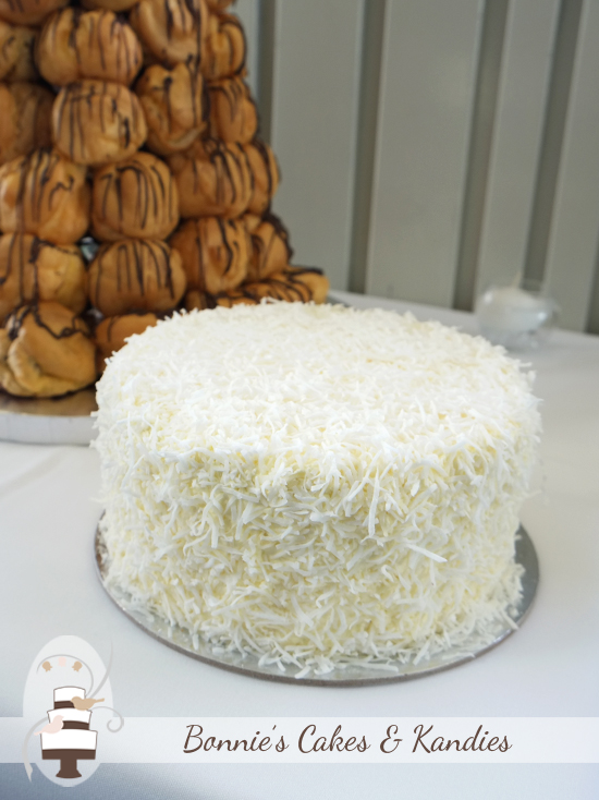 White chocolate coconut mud cake and croquembouche Noosa Wedding