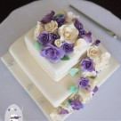 Ivory purple roses with paw prints gluten free dairy free elegant Maleny Manor wedding cake by Bonnies Cakes and Kandies