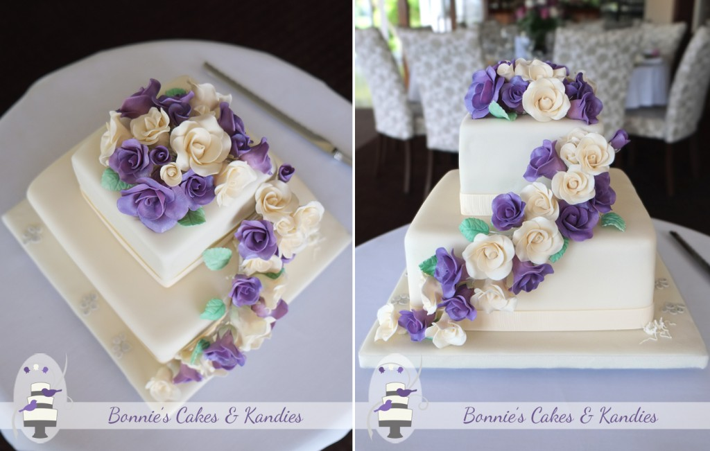 A full posy and cascade of purple and ivory icing roses, with subtle silver paw prints decorated this Maleny Manor wedding cake  |  Bonnie's Cakes & Kandies