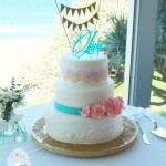 Glittering gold on a perfect summer's day  {Rainbow Beach wedding cake}