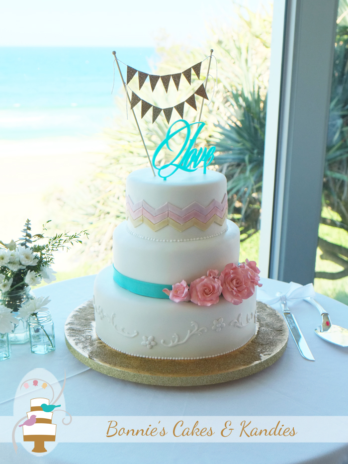 Glittering golden sand, perfect weather, and a custom designed beach wedding cake  |  Bonnie's Cakes & Kandies