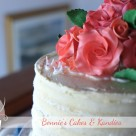 Coral coloured icing roses decorate a buttercream cutting cake for an intimate Castaways Beach wedding on the Sunshine Coast  - Bonnie's Cakes & Kandies, Gympie, Rainbow Beach, Noosa, Sunshine Coast, Sunshine Coast Hinterland wedding & special occasion cake decorator.