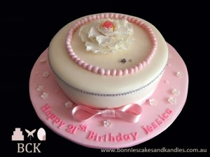 Pretty pink 21st cake: chocolate mud cake with caramel fudge filling.
