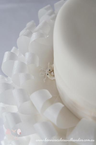 Sweet little doves (my little-known cake 'signature') nestled at the base of the frills on this beautiful Mooloolaba wedding cake | Bonnie's Cakes & Kandies, Gympie & Sunshine Coast.