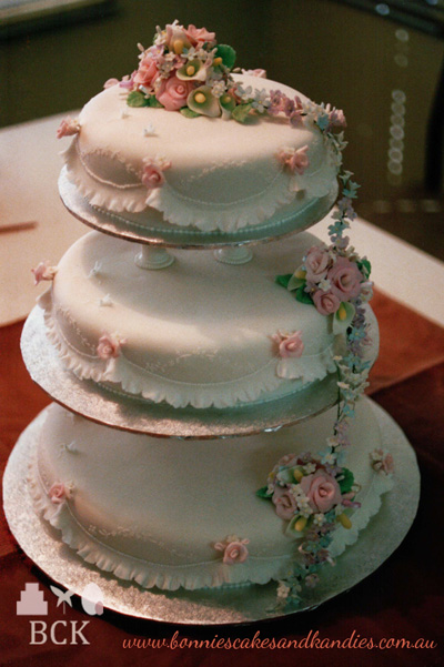 Vintage 3 tier wedding cake with pillars, garrett frills, piped embroidery, and a waterfall of icing flowers. From the vault of my June 1990, Mount Isa wedding cakes | Bonnie's Cakes & Kandies.