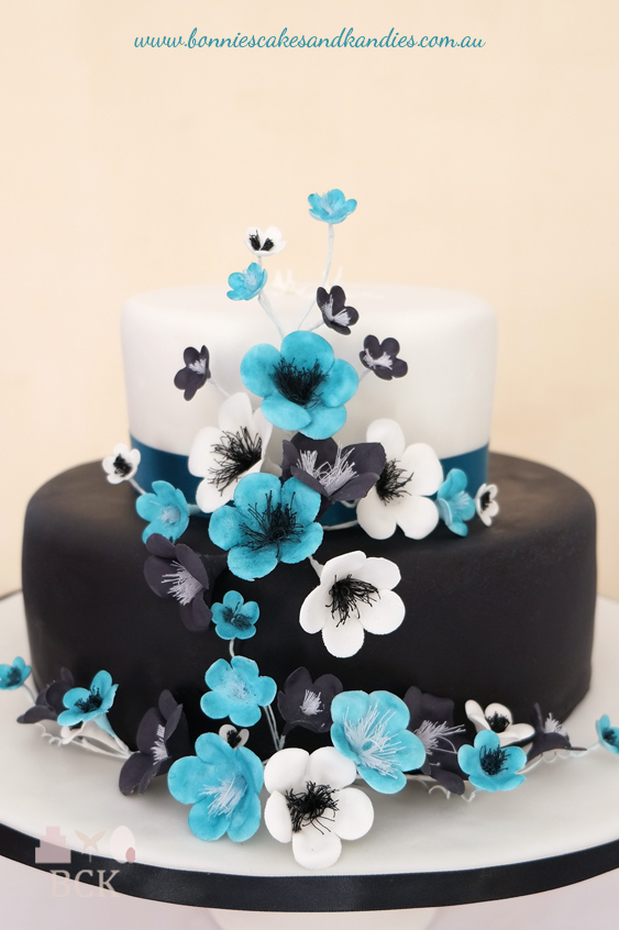 Black, white & blue icing or flower paste flowers decorated the front of Timara & Kane's engagement cake  |  Bonnie's Cakes & Kandies, Gympie.