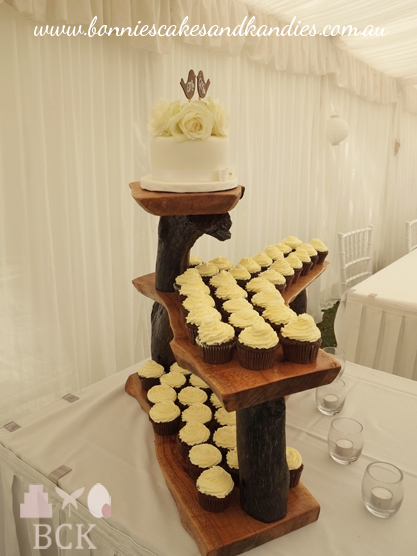 Another view of Tom & Melissa's cupcakes and cutting cake on the timber stand  |  Bonnie's Cakes & Kandies, Gympie.