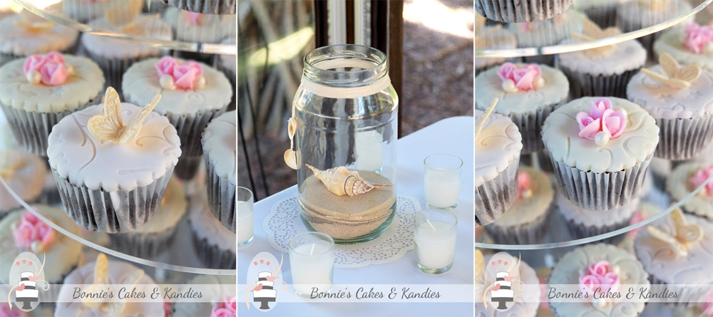Cupcakes decorated with piped rosebuds, pearls & butterflies, and a beautiful beach-themed table setting by the team at Rainbow Shores  |  Bonnie's Cakes & Kandies.