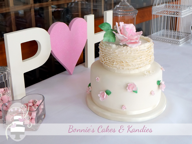 Delicate, soft pink roses and gorgeous fondant ruffles combined beautifully into an elegant wedding cake, made in traditional fruit cake and dark chocolate mud cake  |  Bonnie's Cakes & Kandies Gympie, Rainbow Beach