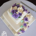 Ivory and purple roses for a summer wedding at Maleny Manor   {Maleny Wedding Cake}