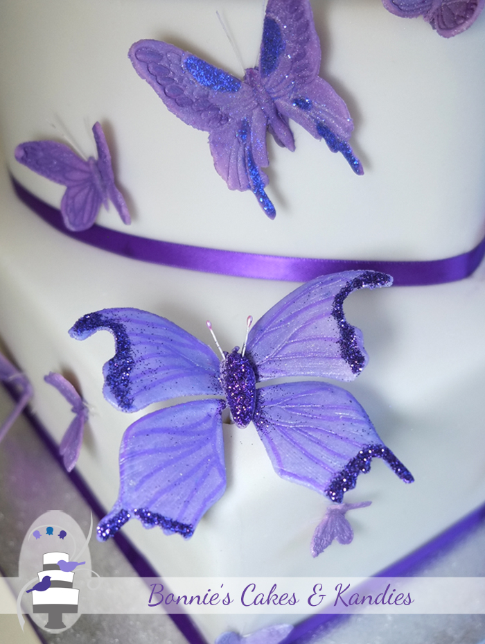 Handmade butterflies added a special touch to the wedding cake    Bonnie's Cakes & Kandies