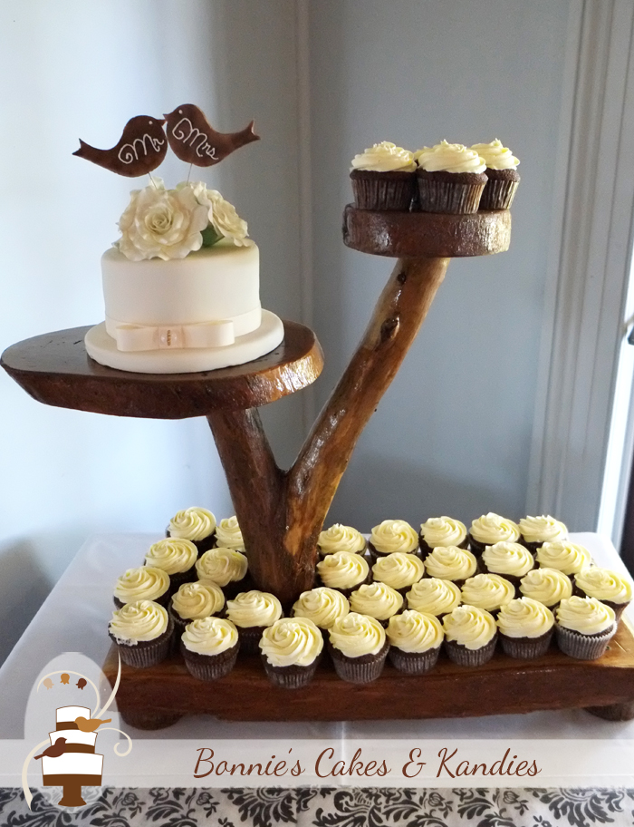 wedding cake and cupcakes together two lovebirds one story gympie wedding cake 21736