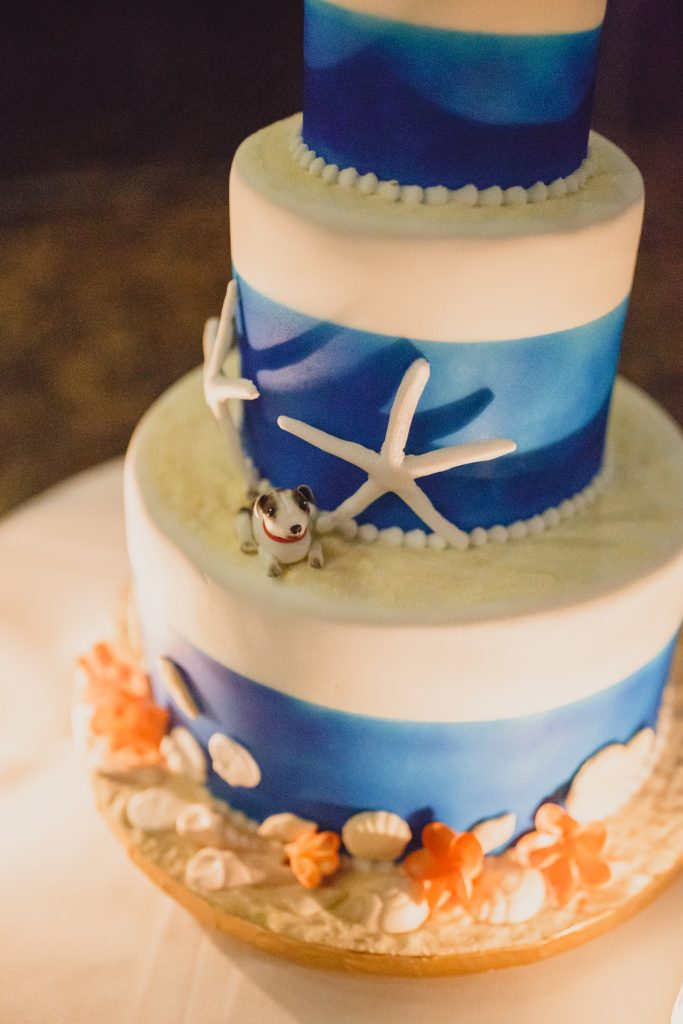 Icing dog decorating a seashell and sand beach themed wedding cake at Fraser Island made by Bonnie's Cakes and Kandies